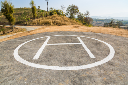 helicopter pad: Helicopter pad on remote mountain, the first pad is marked with H
