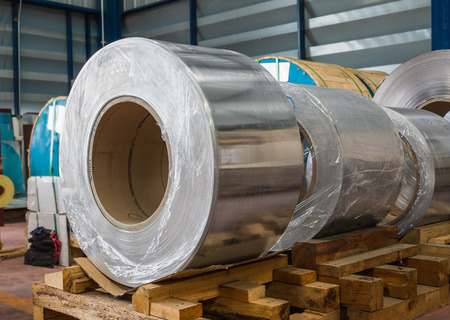 Aluminium rolled products or aluminium coils in storage area conductor raw material Stock Photo