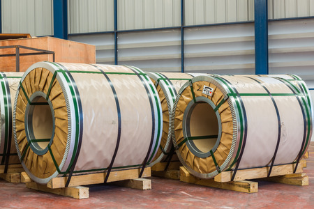 cold storage: Cold rolled steel or silicon steel coils in storage area in warehouse Stock Photo