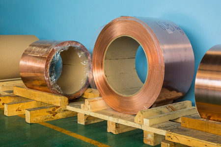 Copper rolled products or copper foil sheet in storage area, conductor raw material for transformer manufacturing Stock Photo