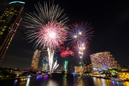 chao phraya: BANGKOK, THAILAND - 01 JANUARY 2016 - New year fireworks over the Chao Phraya river in front of various luxury hotels and condominiums along the waterfront, Bangkok, Thailand