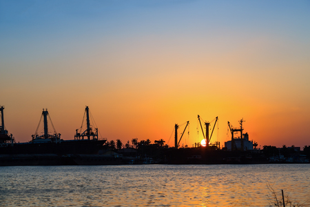 chao phraya river: Sunset at the ports on Chao Phraya river shore for water transportation Stock Photo