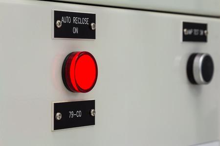 pilot light: Illuminated push button switch on panel of control cubicle Stock Photo