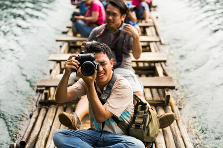 thani: SURAT THANI, THAILAND - 12 SEPTEMBER 2015 - Unidentified tourists take photo from bamboo raft while travel on bamboo raft in Cheow Lan reservoir in Surat Thani province, Thailand. Editorial