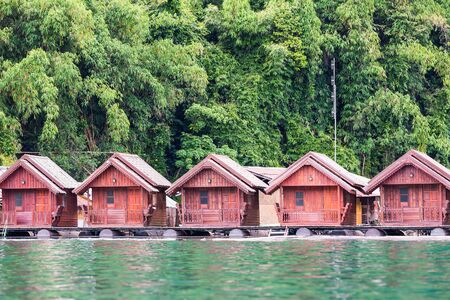 afloat: Lakeside floating houses or raft houses for tourists in Cheow Lan reservoir in Surat Thani province, Thailand. Editorial
