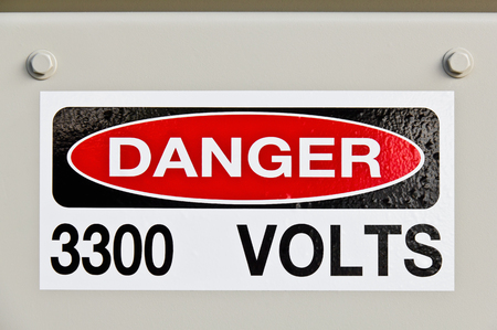 volts: High voltage 3300 volts danger sign on electrical equipment