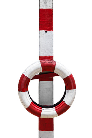 margin of safety: Red and white barricade made of tires installed on the poles for crash protection, isolated on white background with clipping path