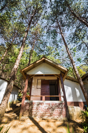 lodging: Wide angle view of lodging house among the pine trees at Pang Ung Pang Tong reservoir, Mae Hong Son province, Thailand Stock Photo