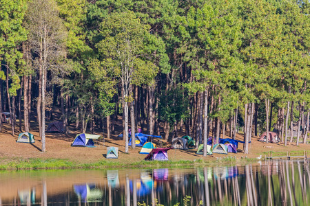 flysheet: Dome tents beside the lake in camping site at Pang Ung Pang Tong reservoir, Mae Hong Son province, Thailand Stock Photo