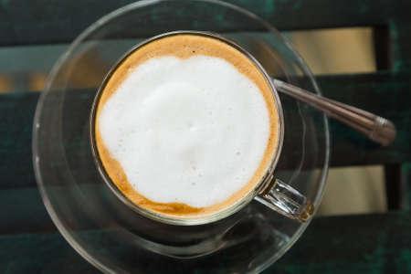 mocha: Hot coffee mocha on glass top table, top view