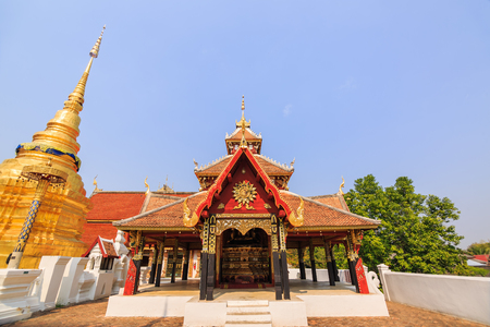 multi layered: Wide angle view of multi layered roof and cruciform shaped pavilion named Viharn Phra