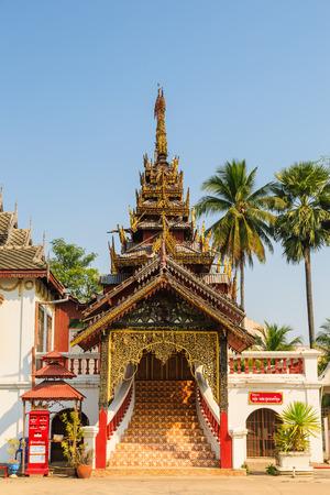 chum: LAMPANG, THAILAND - 05 FEBRUARY 2016 - Multi layered roof traditional Burmese style chapel of Wat Sri Chum in Lampang province, Thailand.