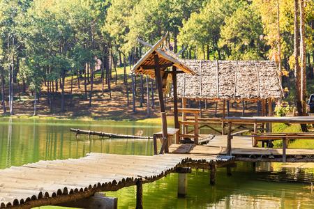 serenity: Serene nature view of lake, bamboo bridge, and gazebo at Pang Ung Pang Tong reservoir, Mae Hong Son province, Thailand