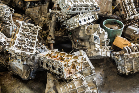 pile reuse engine: Scrapheap of car engine and transmission Stock Photo