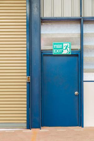 evacuacion: Steel exit door for emergency evacuation, Thai word on the exit sign means exit