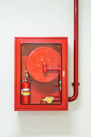 wall mounted: Wall mounted fire hose and extinguisher cabinet and water plumbing