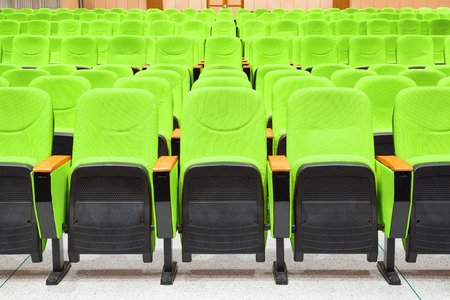 armchairs: Empty conference hall with green armchairs