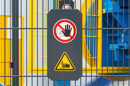 be careful: Warning sign for safety on machine, no entry and be careful of hand