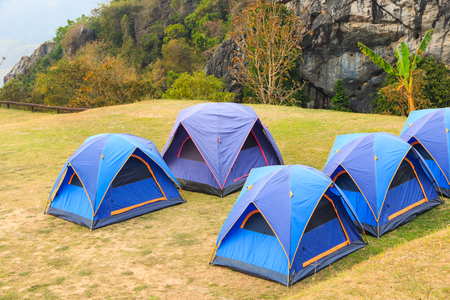 Dome tents on camping site on the mountain beside the cliff at Doi Samer Dao in Nan province, Thailand