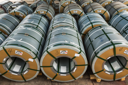 oriented: Cold rolled grain oriented electrical steel (CRGO) coils in storage area in warehouse or in factory