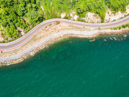 Aerial view from drone of coastal road with bike lane to Nang Phaya Hill Scenic Point in Chanthaburi, Thailand Stock Photo