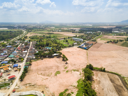 developed: Aerial view of developed flattened land near the village for housing or agriculture, Thailand Stock Photo