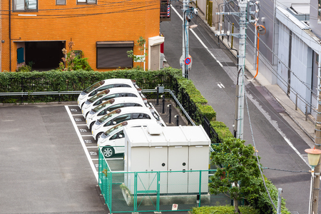 Electric car or Electric Vehicle (EV) parking lot with charging station in Tokyo, Japan 写真素材