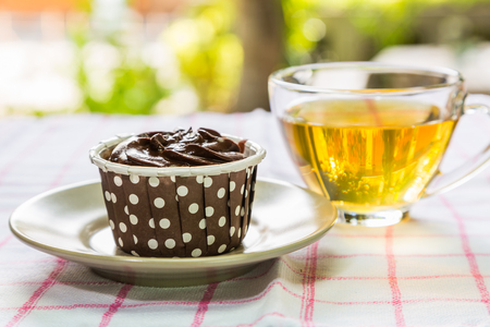 chic: Chocolate cupcake with a cup of tea, for break time