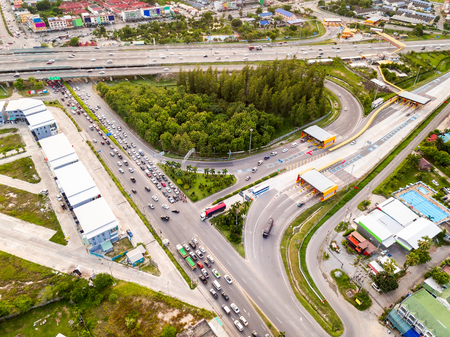 Aerial view from drone of T-junction at the exit and entrance to expressway (motorway), Thailand