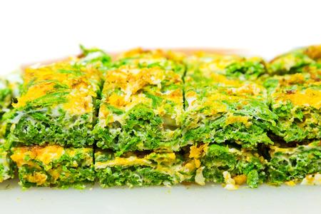 Climbing wattle (Cha-om) omelette, cutting into rectangular pieces