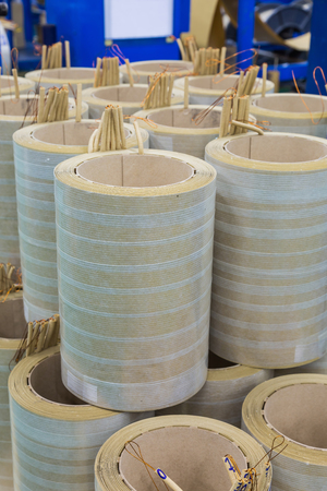 HT (high tension) or HV (high voltage) round windings of oil immersed distribution transformers Фото со стока
