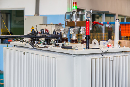Three phase oil immersed transformer with plug-in type HV bushing under load loss test, HV bushings are connected to testing voltage (impedance voltage) while LV terminals are short circuited