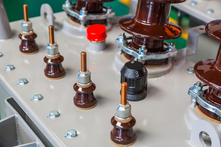 Components on tank cover of three phase oil immersed distribution transformer, focusing on off-load tap changer knob