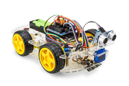 Programmable four wheels drive (4WD) robotic car with obstacle avoidance and line follow ability, isolated on  background with