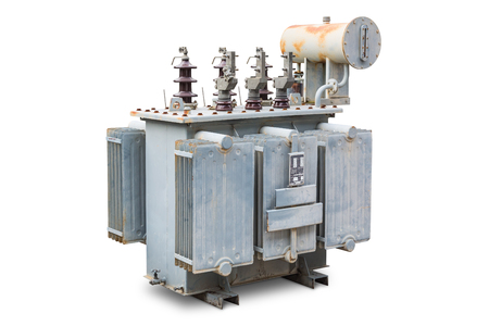 Old three phase open type oil immersed transformer with radiator fin and conservator tank, isolated on background with