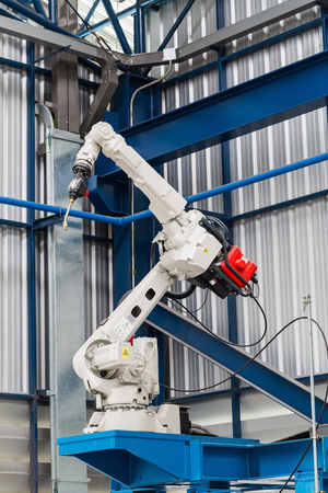 Robotic arc welding machine in smart factory in metalwork industry Reklamní fotografie