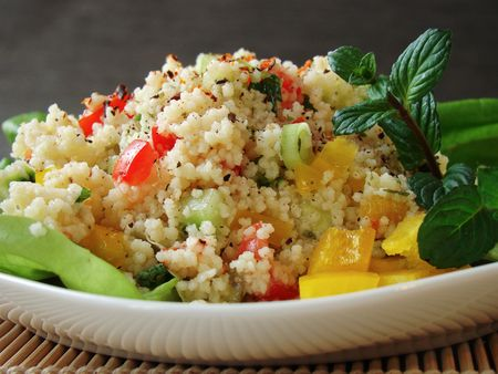 Close up of a traditional Arabian dish: Tabouleh salad with couscous, tomatoes and parsley.