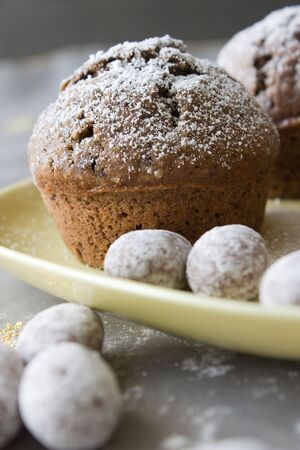 Closeup of Christmas decorated muffin with chocolate on a yellow plate photo