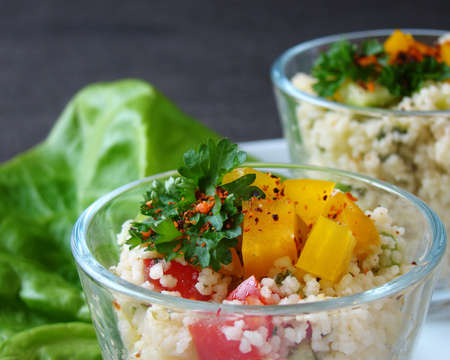 Close up of a traditional Arabian dish: Tabouleh salad with couscous, tomatoes and parsley. photo