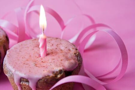 Muffin with pink icing and a candle, suitable for birthday, Valentine Day or celebrate a jubilee Stock Photo - 6066050