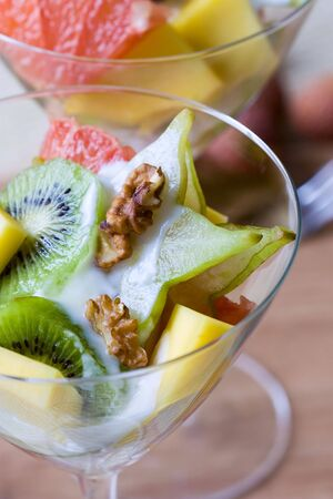 Selective focus image of a tropical fruit salad made from grapefruits, mango, star and kiwi fruits. Stock Photo - 6558795
