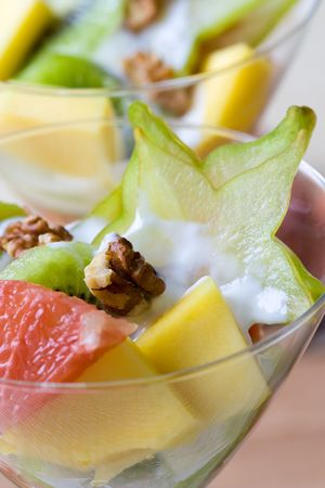 Selective focus image of a tropical fruit salad made from grapefruits, mango, star and kiwi fruits. Stock Photo