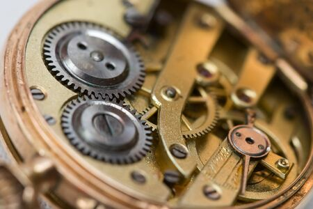 watchmaker: Full frame image of the clockwork of a pocket watch. Stock Photo