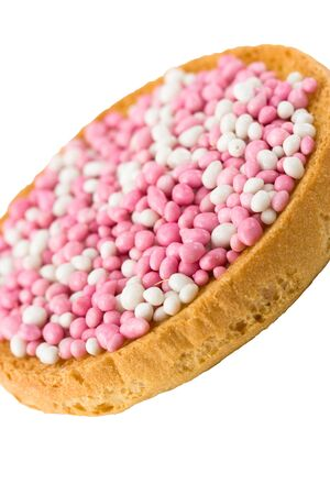 In the Netherlands, it is a custom at the birth of a baby girl to eat pink and white muisjes on top of Dutch biscuits or round rusks called beschuit. Muisjes are made of aniseed sprinkles with a sugared  and colored outer layer Stock Photo - 7001061