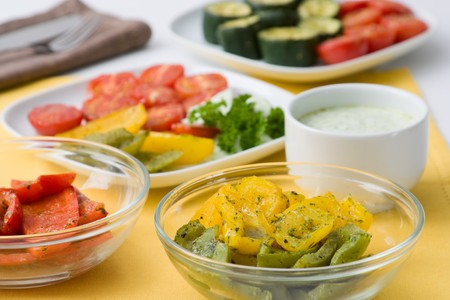 Selective focus image of a table with grilled vegetables like pepper, courgette and tomatoes. Stock Photo - 7236233