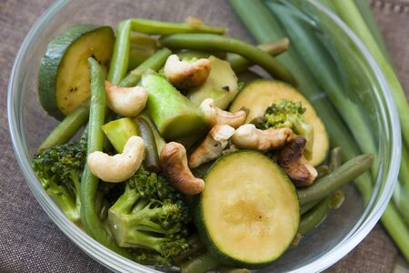 Fried vegetables in green colors made from beans, broccoli and green squash decorated with Stock Photo - 7266741