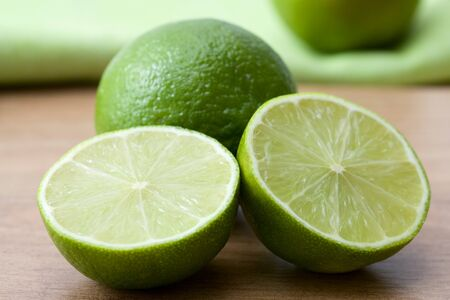 Close-up of cutted green limes on a wooden background. Stock Photo - 7545915