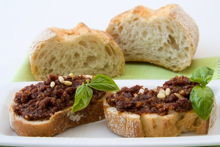 Close-up image of bruschetta with tomato pesto, some Italian antipasti. photo