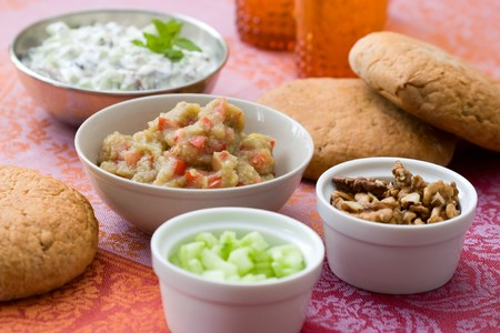 Traditional meze buffet with oriental dips from aubergines and from yoghurt with cucumbers. Stock Photo