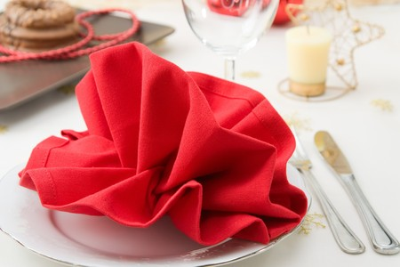 Christmas decorated table for a menu with red folded napkin. Stock Photo - 7946787